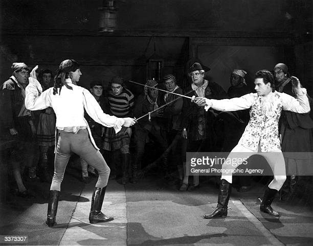 A fencing duel scene from the pirate film 'Contraband' produced by Fred Leroy Granville