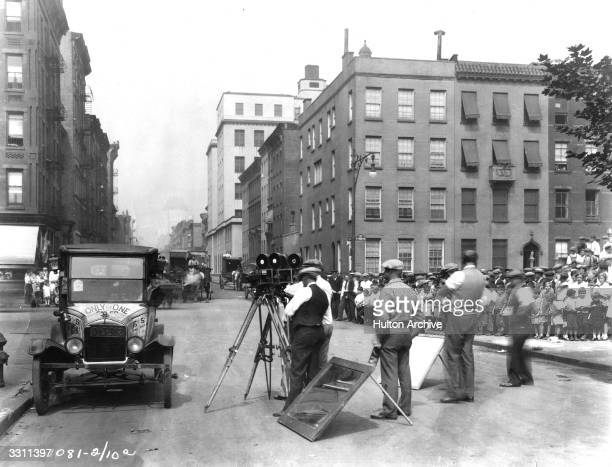 A film crew in a New York street shooting scenes for a Harold Lloyd film