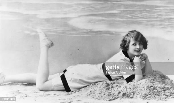 A girl modelling beach wear from a postcard