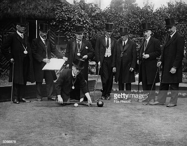 A group of players dress formally on the Old Southampton Bowling Green the world's oldest