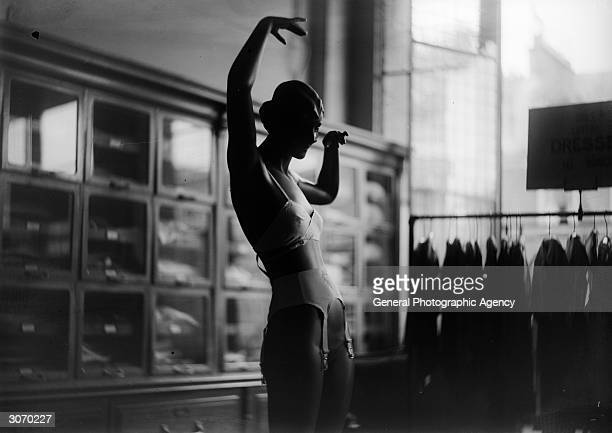 A mannequin in a department store dressed in a suspender belt and bra The shop is possibly Harrods of London during their Great Summer Sale