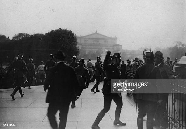 A policeman beating a disturber of the peace during the opening of the Reichstag