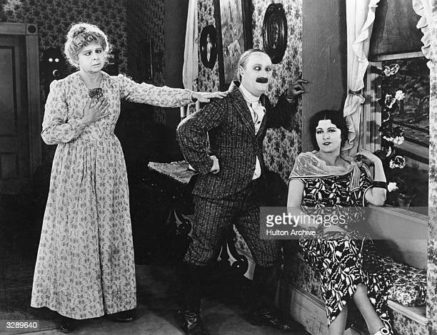 A scene from the Mack Sennett comedy 'Where Is My Wandering Boy This Evening' showing Dot Farley as Ben Turpin's mother trying to save him from the...