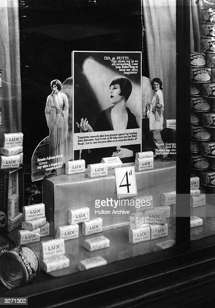 A shop window display advertising bars of 'Lux' soap featuring film actresses Renee Adoree Lya De Putti and Janet Gaynor
