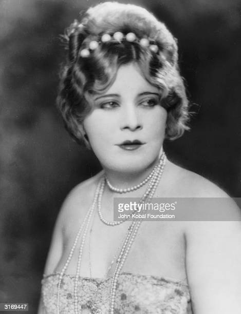 Young Mae West wearing pearls. Before being discovered by Hollywood, Mae West was a successful broadway performer and writer. Her play, 'Diamond Lil'...