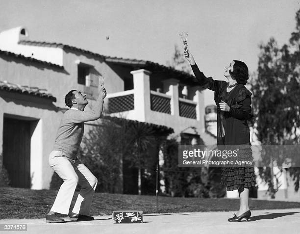 Actor Buster Keaton and Conchita Montenegro indulge in a game of 'Bang Ball'