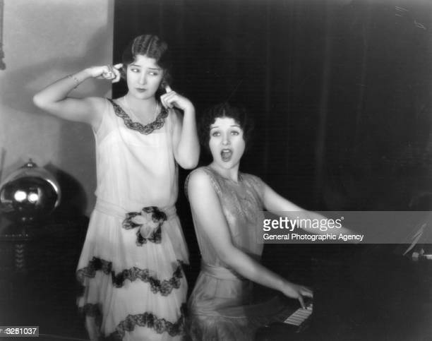 Alice and Marceline Day two American film actresses are performing together at their Wilshire Boulevard home Hollywood Marceline sitting at the piano...
