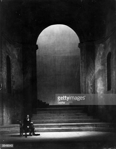 American actor John Barrymore drawfed by the set at London's Haymarket Theatre during a soliloquy scene in his role as Hamlet