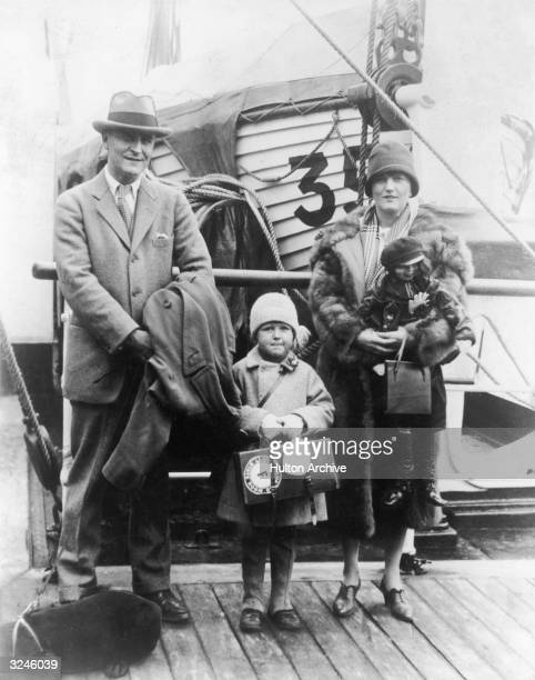 American author F. Scott Fitzgerald poses on a pier with his wife Zelda and their daughter Frances Scott , after arriving from Europe aboard a liner.