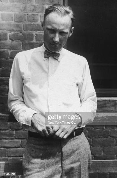 American educator John Scopes stands in front of a brick wall He was prosecuted in 1925 for teaching Darwin's theory of evolution in a Dayton...