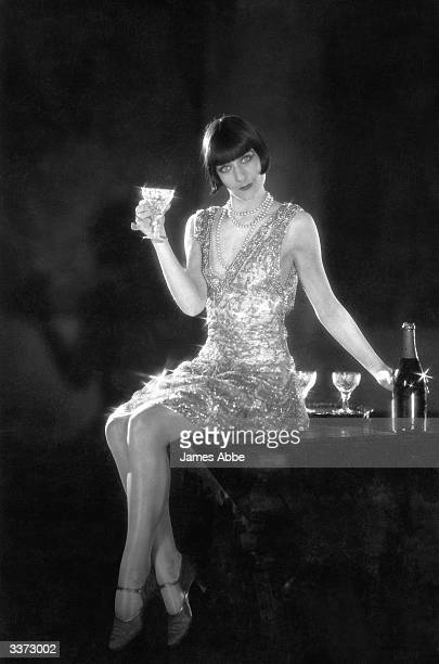 An actress in the German film 'London' with a glass of champagne