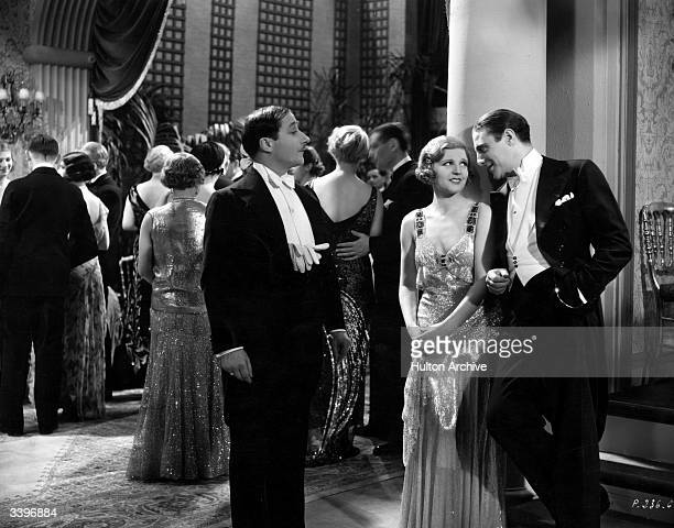 An onlooker detects a whiff of love in the air as a young couple flirt at a party in a scene from an unknown film