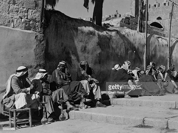 Arab labourers line up by the Damascus Gate in Jerusalem in anticipation of employment