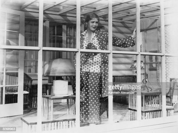 AustroHungarian actress Vilma Banky one of Samuel Goldwyn's stars gazing through the window of her Malibu beach house