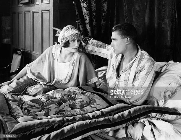 Brian Aherne the British leading man of stage and screen and Gladys Crabbin argue in bed in a scene from 'King Of The Castle'.