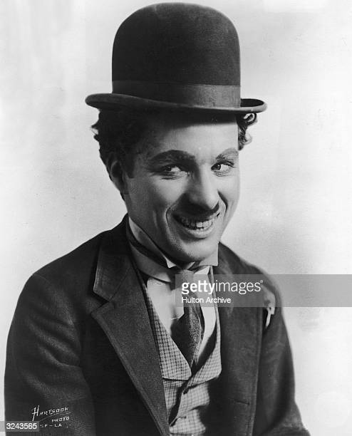 British comic actor and film director Charles Chaplin in character as the Little Tramp