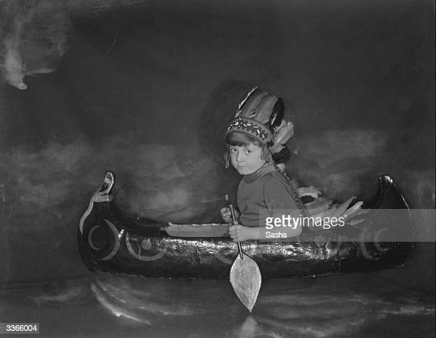 Christopher Robin Milne immortalized with his toy bear WinniethePooh in his father A A Milne's children's classics paddling his toy canoe dressed as...