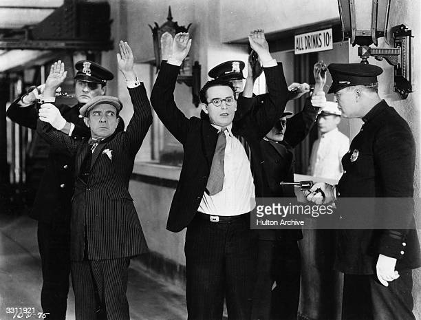 Comedian Harold Lloyd being arrested in a scene from one of his films