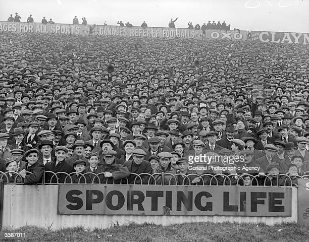 Crowds pack the stands to watch a football match
