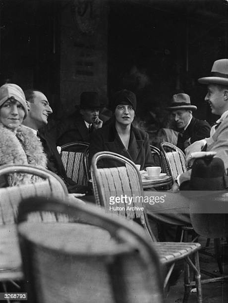 Customers at tables outside a patisserie in Paris