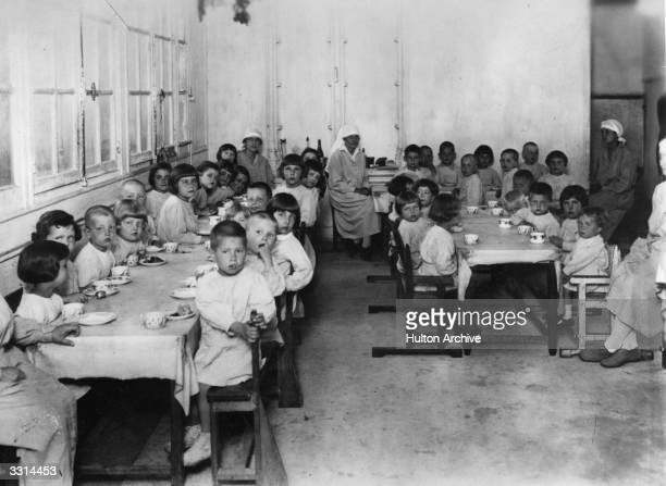 Destitute Russian children being served a meal in an orphanage.