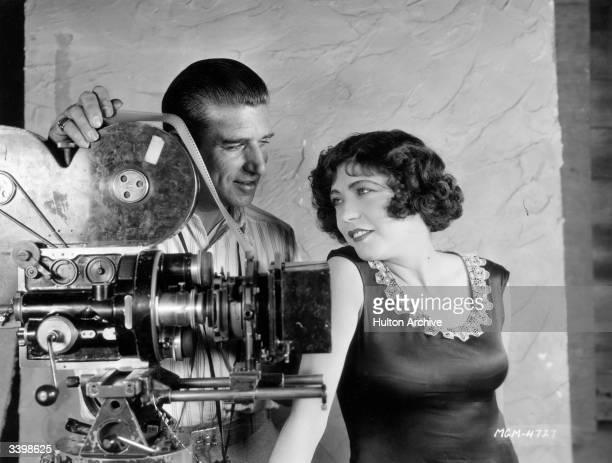 French actress Renee Adoree and MGM cameraman John Arnold beside his camera