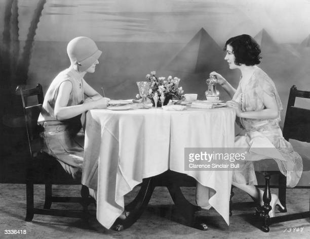 French born actress Renee Adoree eating lunch with a newspaper reporter