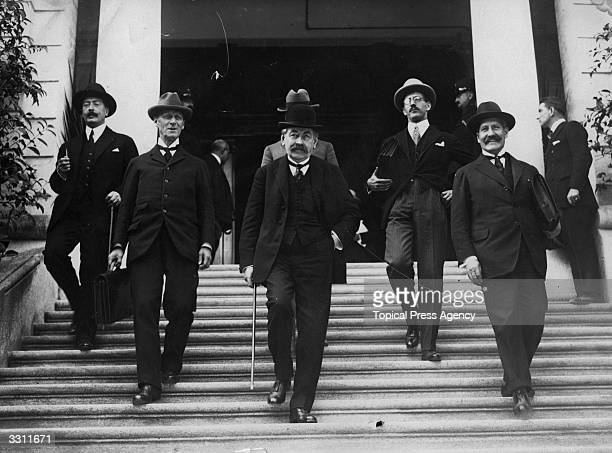 French statesman Aristide Briand with his delegation at negotiations over the Locarno Pact an agreement of mutual nonaggression throughout Europe