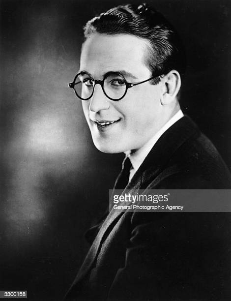 Harold Lloyd the American comedian and film comic Wearing thick hornrimmed glasses and a straw hat he performed numerous daring stunts for laughs...