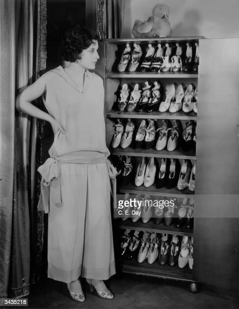 Hollywood actress Evelyn Brent , with her collection of shoes.
