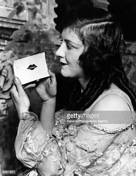 Irene Regan with a Valentine card imprinted with a lipstick kiss