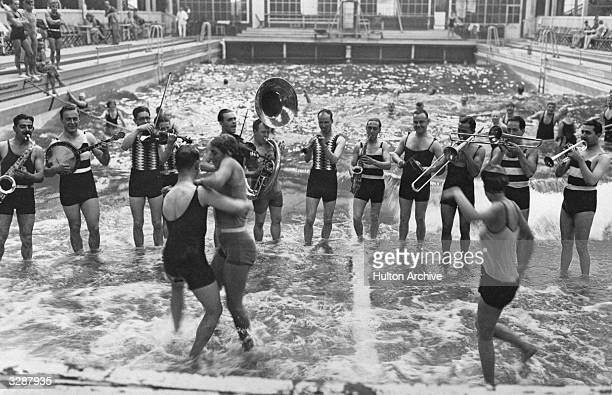 Jack Hylton's Band plays for bathers at the Luna Park Baths in Berlin