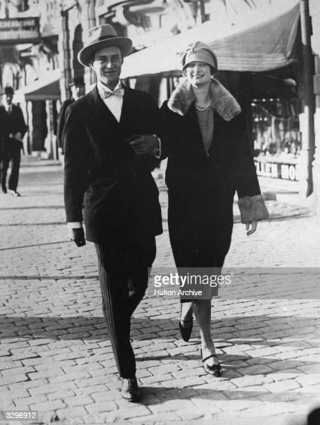King Leopold III of Belgium walking in the street with Queen Astrid