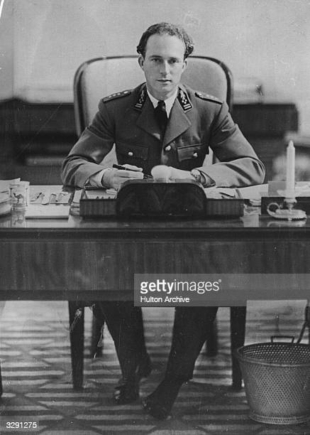 Leopold III King of the Belgians as a young man in uniform seen sitting at his desk