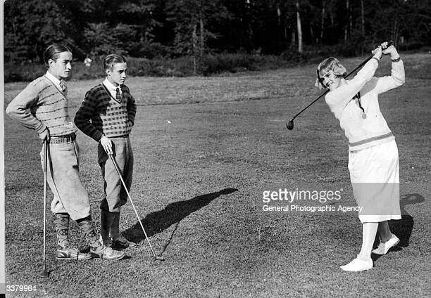Maureen Orcutt the 18yearold Women's Eastern Golf Champion undertakes the training of her twin brothers Benjamin and William at the White Beeches...