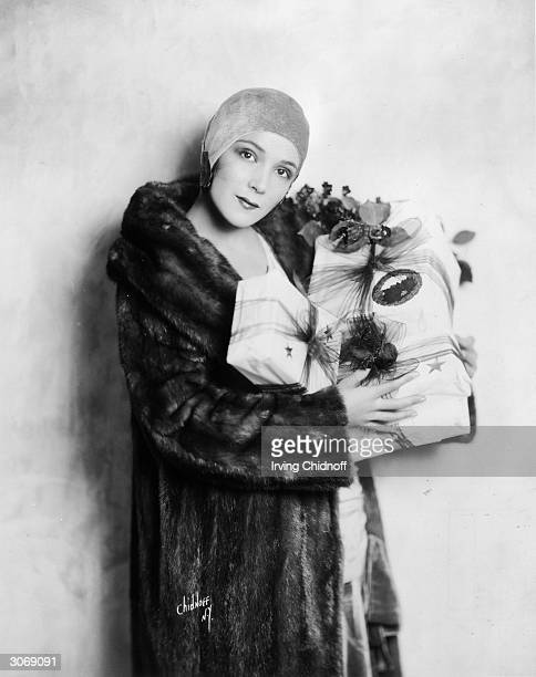 Mexican actress of the silent era, Dolores Del Rio , with some christmas presents.