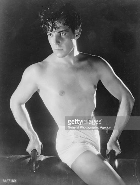 Mexican heartthrob Ramon Novarro on a gymnasium horse