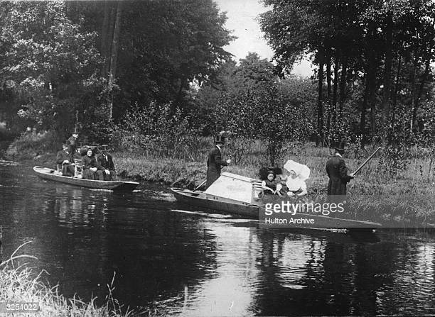Mourners travelling by boat to the churchyard on the River Spree Germany