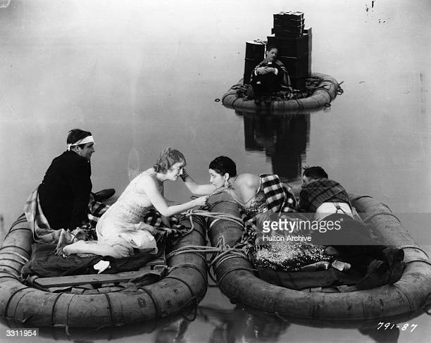 Partygoers marooned on rafts in a scene from the film `Let's Go Native' Title Let's Go Native Studio Paramount Director Leo MacCarey