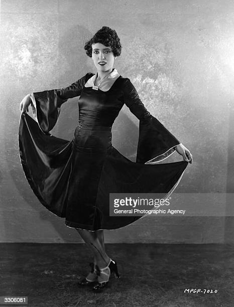 Pauline Starke the Hollywood film star models a dress from her latest MGM production 'A Little Bit of Broadway'