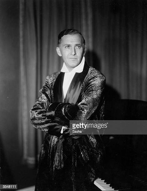 Professional pianist Melville Gideon wearing a smoking jacket