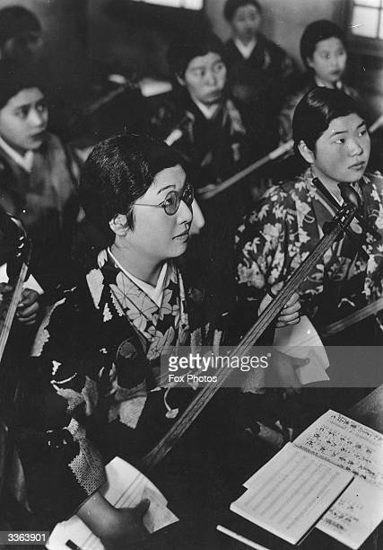 Pupils of Miwata High School for Girls learning to play the shamisen