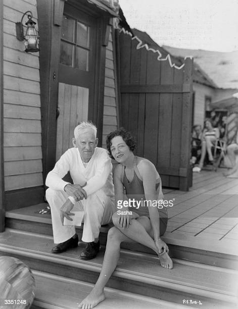 Silent film star Pauline Frederick on the steps of her beach bungalow with her agent Major Morris J Herbert