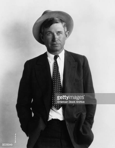 Studio portrait of American actor humorist and lecturer Will Rogers wearing a hat and a polka dot tie with a pinstriped suit
