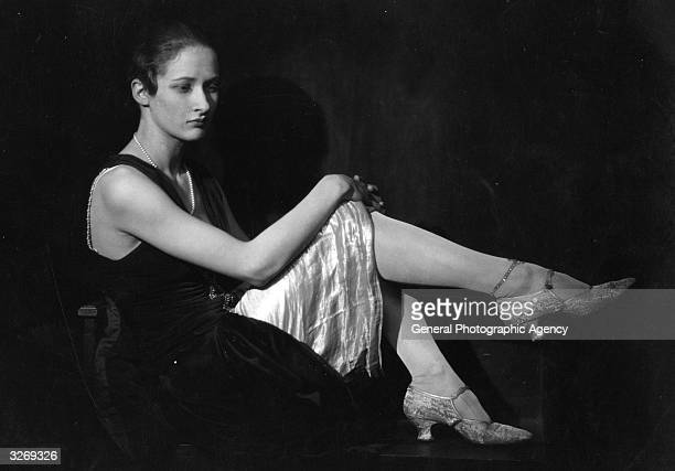 The celebrated West End mannequin beauty and stage star Dorothea Varda wearing stockings stitched with jewels