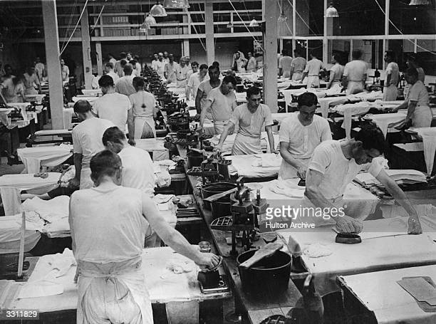 The final iron being given to shirts in a New York textile factory