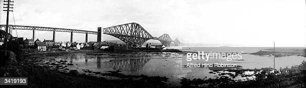 The Forth Bridge which spans the Firth of Forth at Queensferry in Lothian and is over a mile long The steel cantilever construction was designed by...