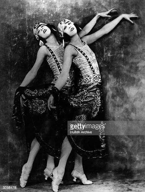 Two young women who perform in a cabaret at the Piccadilly Hotel strike a pose
