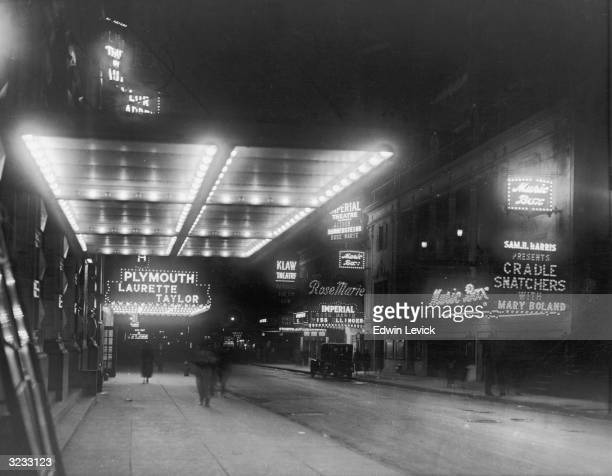 View of marquees for the Plymouth Laurette Taylor the Music Box the Imperial and the Klaw Theaters along 45th Street looking west from Broadway at...