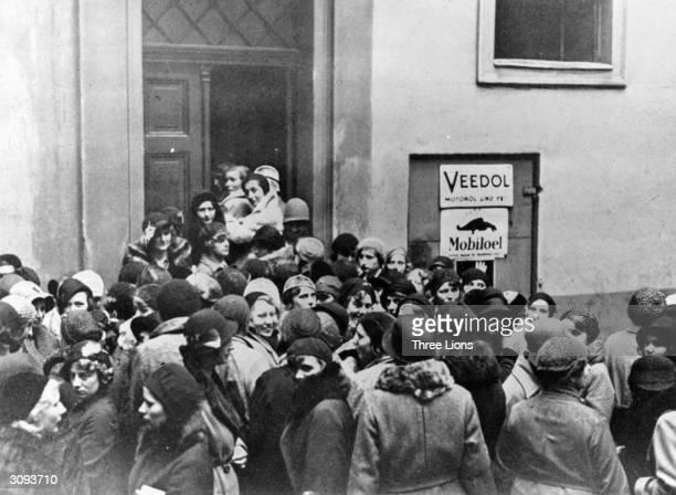 Women outside a building in Munich hoping to fill a single vacancy